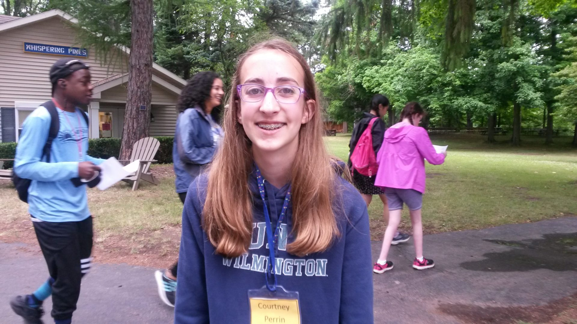 Photo of a teen girl smiling at camp